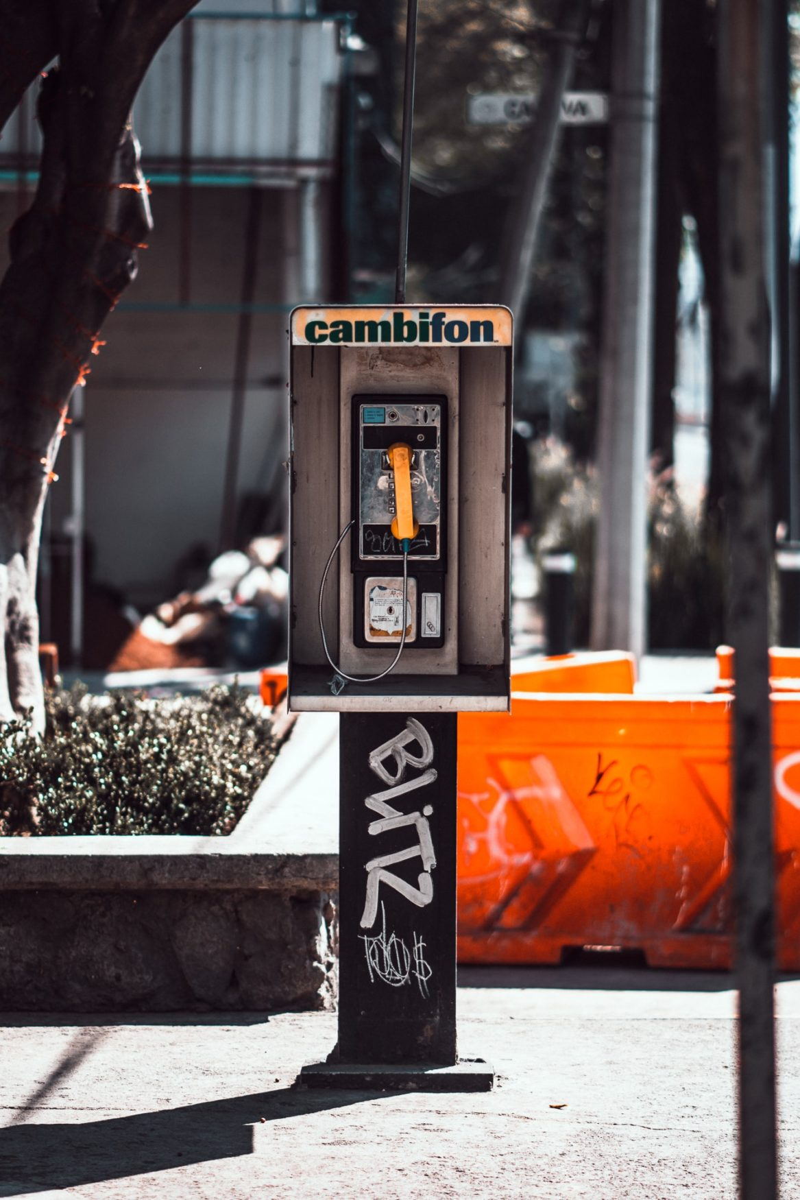 mexico city pay phone with graffiti