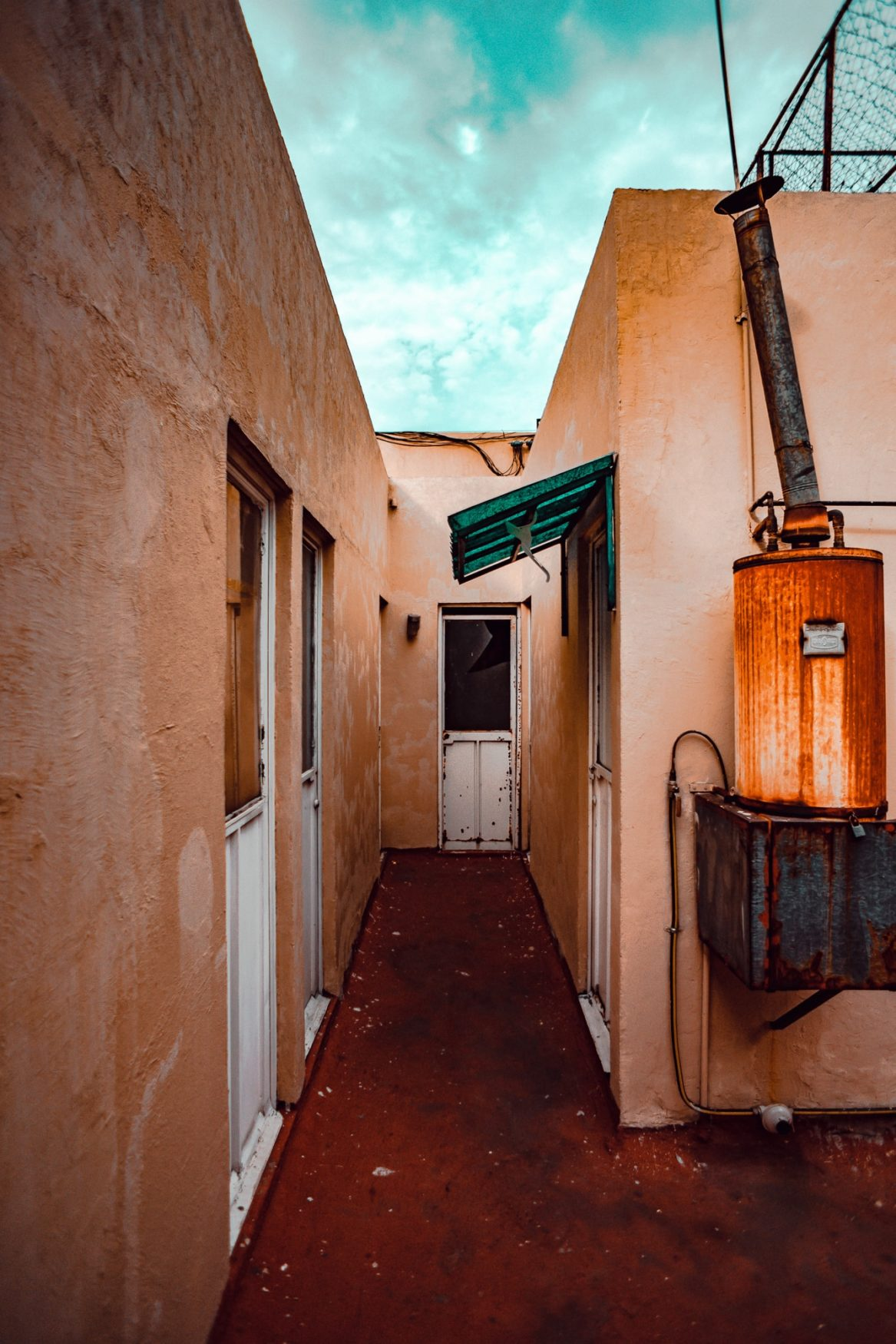 colorful alley with rusted door mexico city